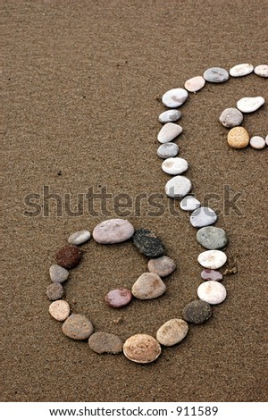 A stone spiral on the beach.