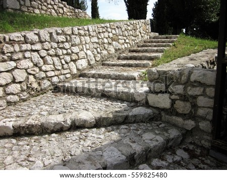a stone staircase in medieval castle #559825480