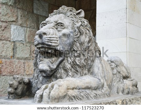 A stone statue of a lion St. Petersburg, Russia. #117523270