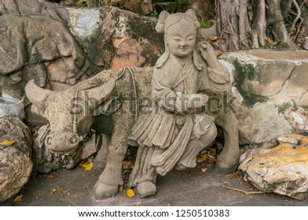 A stone statue of a temple #1250510383