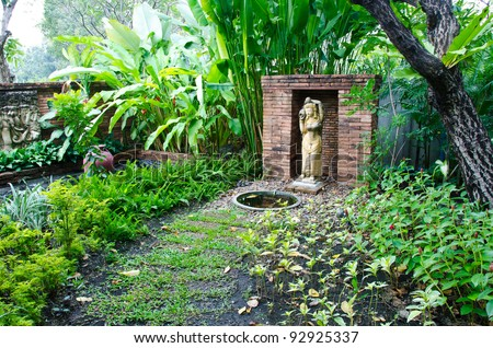A stone walkway in tranquil garden.
