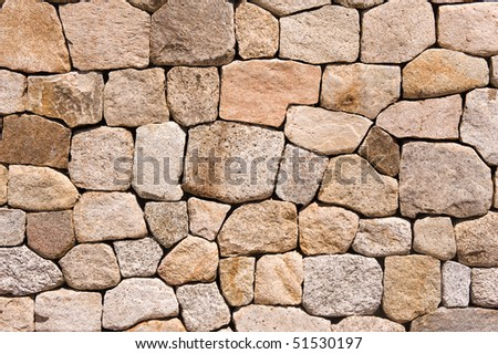 A stone wall during a bright day.