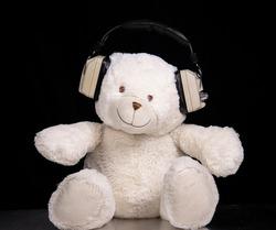 A stop motion teddy bear wearing headphones