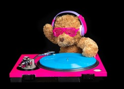 A stop motion teddy bear wearing headphones djing and scratching on record turntables