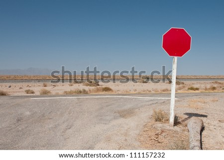 A stop sign in the desert, with the text removed. - stock photo