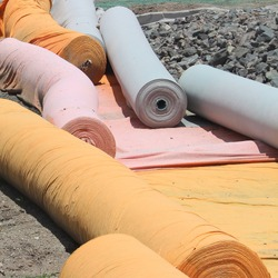 A store of geo textile material rolls on a construction site