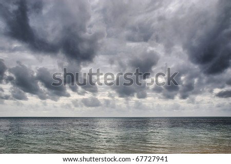 a storm builds up over the Coral Sea near Green Island, North Queensland, Australia