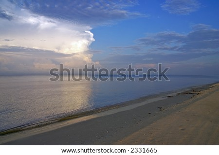 A storm on the horizon in the morning sunrise.