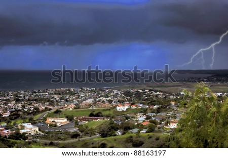 A storm passes through San Clemente with rain in the background