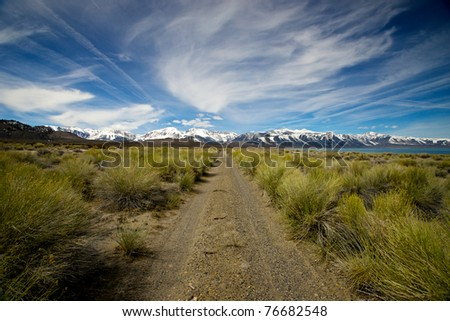 A straight path cuts through the wilderness of eastern California beside Mono Lake toward Yosemite National Park.