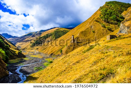 A stream in the mountain valley of the hills. Mountain hill valley landscape. Mountain hills view