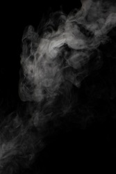 A stream of white smoke on a black background mixes randomly creating bizarre swirl patterns