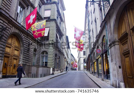 A street in Old Town Geneva with Swiss Flag and Geneva Flag on the 2 sides of the road. Photo stock ©