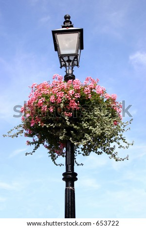 A street lamp decorated with bright flowers.