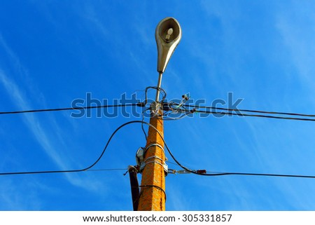 A street light.Outdated electric line. Photo stock ©