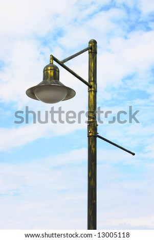 A street light with blue sky as background.