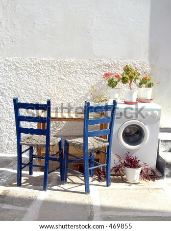 a street scene in the greek islands Paros Parikia cyclades with white architecture