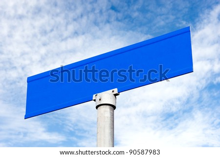 A Street sign against a cloudy, blue sky with copy space for designers to place text.
