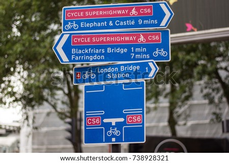 A street sign in London indicates to cyclists an intersection along the Cycle Superhighway CS6 towards Elephant and Castle, Farringdon, Blackfriars Bridge and London Bridge Station