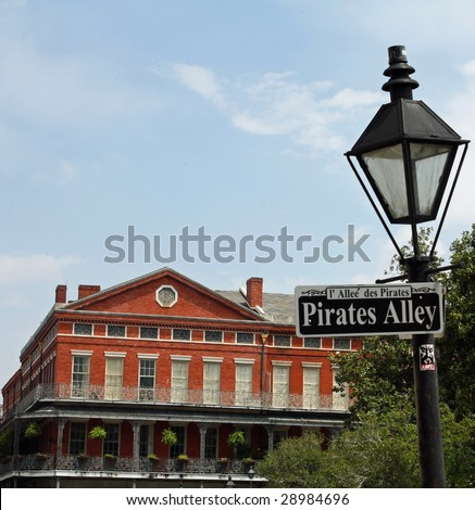 A street sign in New Orleans, Louisiana - Pirates Alley. - stock photo