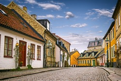 A street with old buildings in the downtown of Lund, Sweden