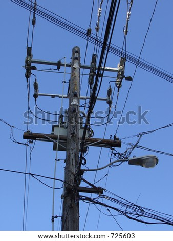A streetlight / power pole with its assorted equipment.