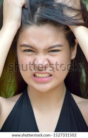 A Stressed Attractive Filipina  Female