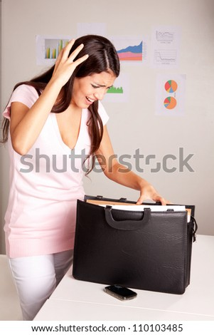 A stressed women who is looking for a lost document