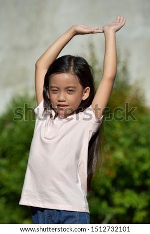 A Stretching Petite Filipina Female #1512732101