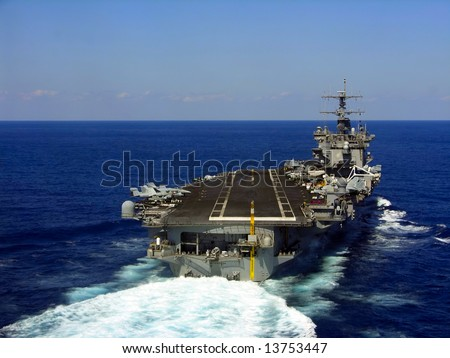 A striking image of a nuclear powered aircraft carrier #13753447
