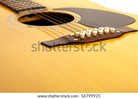 A 12 string acoustic guitar on a isolated background