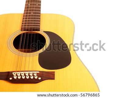 a 12 string acoustic guitar on white