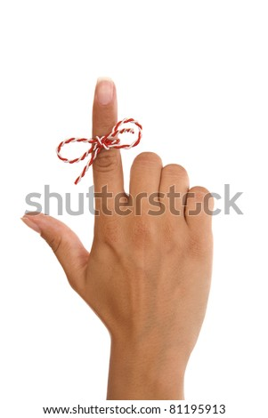 A string on woman finger.... remember something... don't forget, isolated on white background