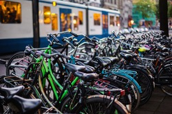 A stroll through the streets of Amsterdam in the evening. Bicycles on a city street. Travel through Europe. Ecological trasport. Night city