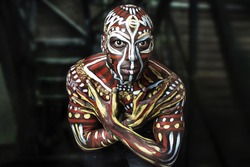 A strong dancer African-American guy. Ethnic African painting. Nigerian Body Art. Studio portrait