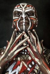 A strong emotional African-American guy. Ethnic African painting. Nigerian Body Art. Studio portrait