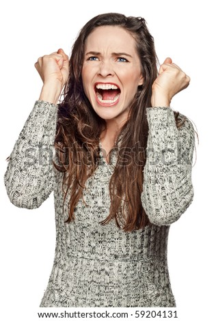 A strong image of a very upset and angry woman screaming and clenching her fists. Isolated on white.
