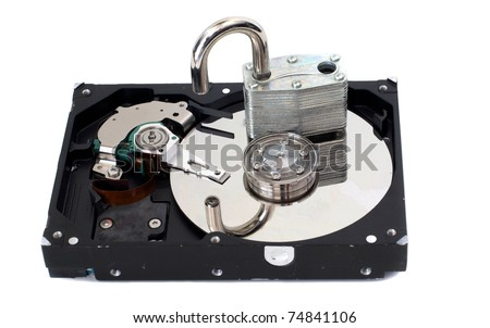 A strong padlock unlocked on top of a hard disk drive.  Depicts a lack of security.