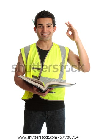 A student apprentice construction worker builder tradesman holding an open book and showing okay sign