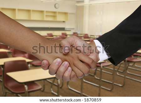 A student meeting the teacher in the classroom of a school