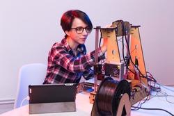 A student woman print prototype on 3D printer