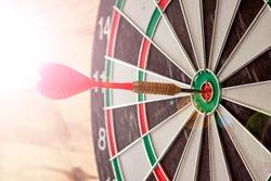 A studio photo of a dart board