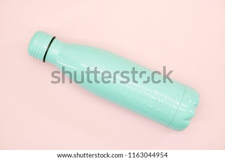 a studio photo of a metal water bottle #1163044954