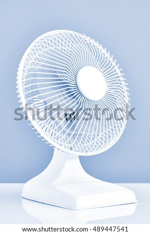 A studio photo of a portable electric fan #489447541