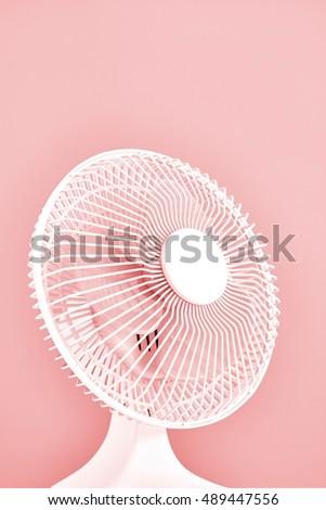 A studio photo of a portable electric fan #489447556