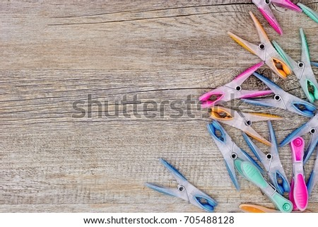A studio photo of clothes line pegs #705488128