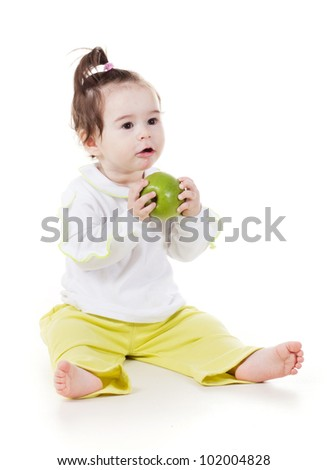 a studio portrait of a smiling little girl with apples isolated on white background
