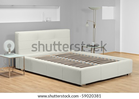 A studio shot of a bed  without mattress