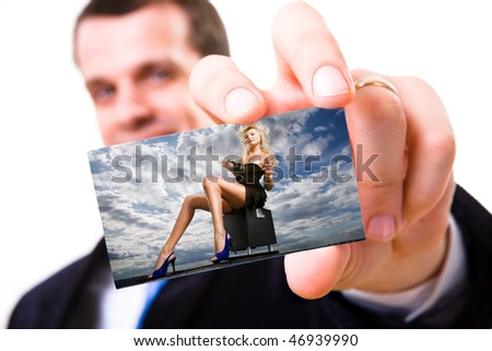 A studio shot of a businessman holding out a card Beautiful girl sitting against a cloudy sky