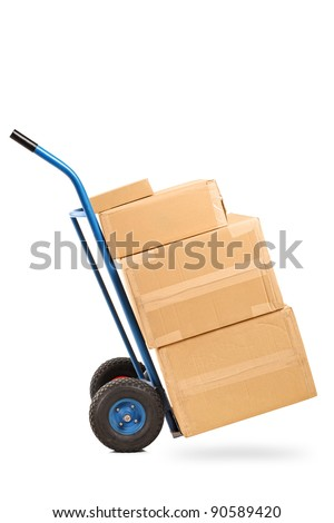 A studio shot of a hand truck with many boxes on it isolated on white background